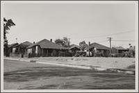 Looking west from Nevin Avenue along Palomares Street; poor Negro quarters; prickly pear