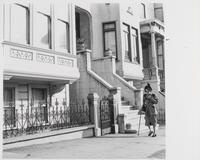 Woman walks down street, San Francisco