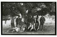 Group portrait of men under a tree, Rancho Santa Anita