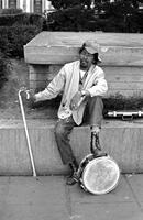 Man with briefcase plays snare drum in Union Square