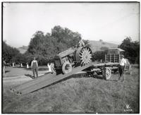 Workers unloading a Faqeol tractor from a Faqeol truck near Oakland, California, between 1910 and 1919