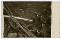 Fire fighters of Engine Co. No. 9 fighting fire, building exterior, Los Angeles