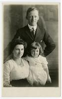 Portrait of fire captain R.E. Dunn with wife and young daughter, Los Angeles